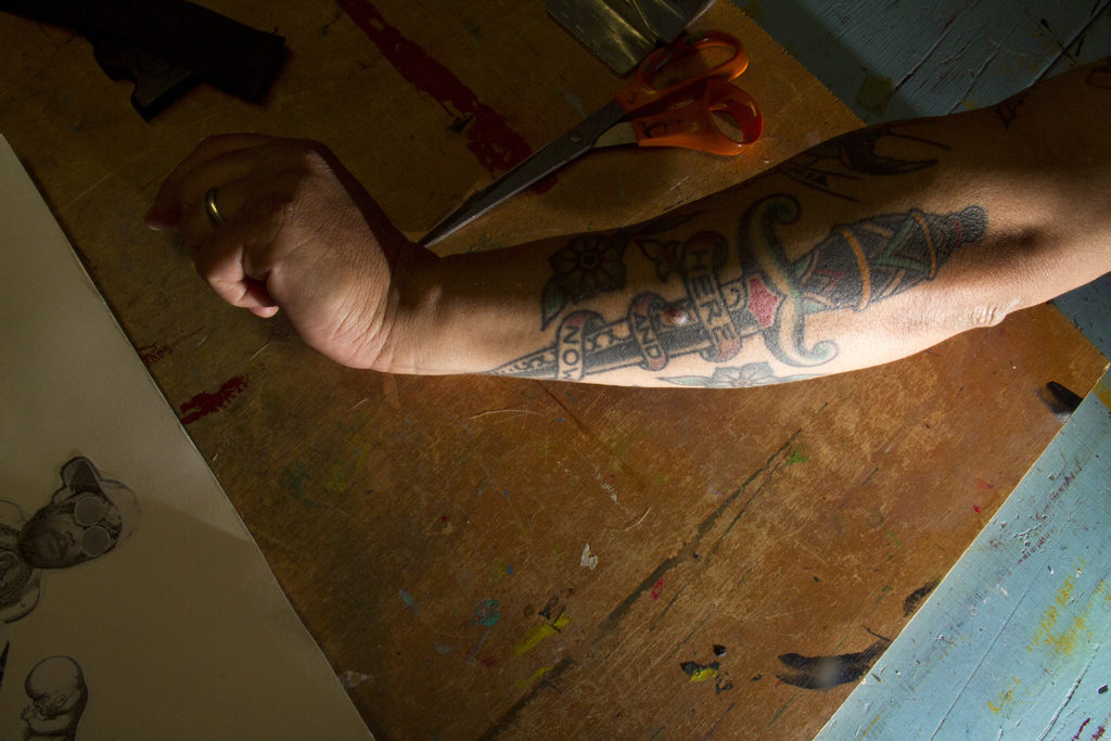 "John Johnston's arm, which reads, ""Here and now."" (Kevin J. Beaty/Denverite)  denver; denverite; colorado; art; nirvana; kurt cobain"