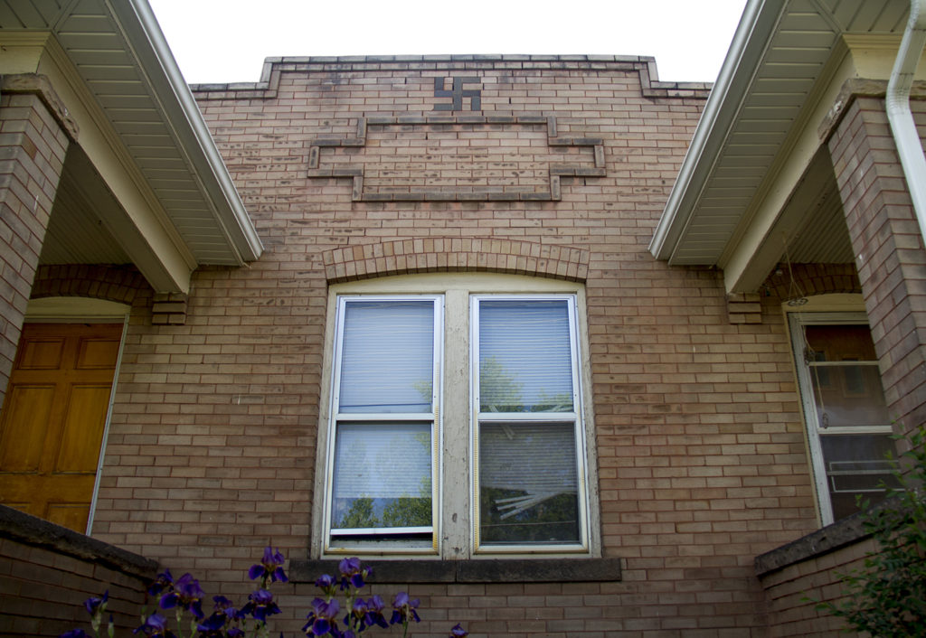 A pre-World War II home bears a soon-to-be taboo symbol. (Kevin J. Beaty/Denverite)  denver; denverite; colorado; kevinjbeaty; swastika; history; architecture; west highland; the highlands;