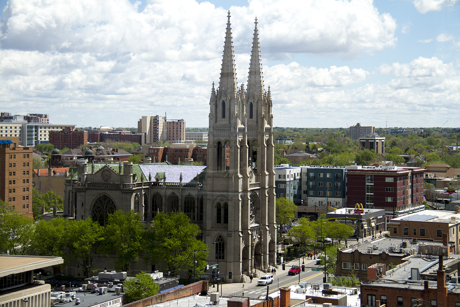 A wide shot of Denver's Capitol Hill and the Cathedral Basilica of the Immaculate Conception on Colfax. (Kevin J. Beatty/Denverite)  denver; denverite; colfax; colorado; cathedral; basilica; church; landscape; kevinjbeaty