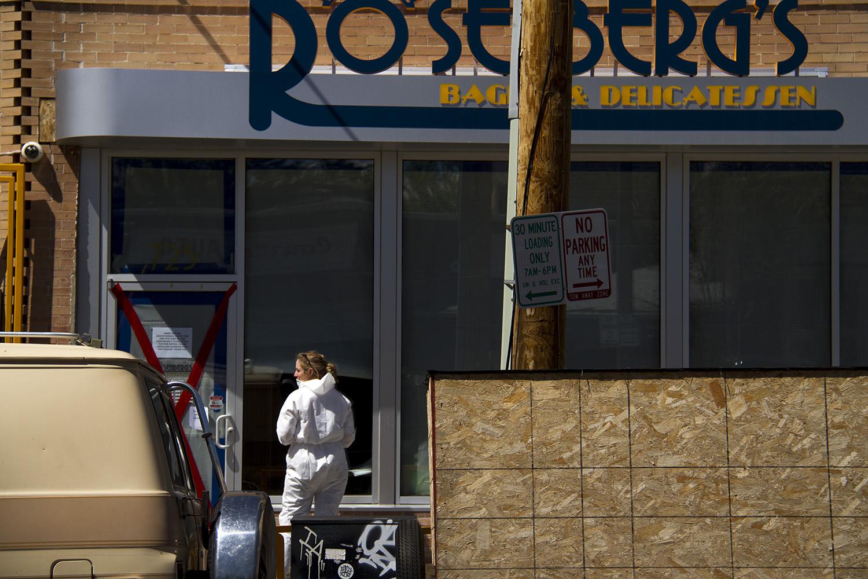 Crime scene investigator locks the door at Rosenberg's Bagels on May 12. (Kevin J. Beaty/Denverite)  rosenberg's; rosenbergs; five points; denverite; denver; colorado; kevinjbeaty