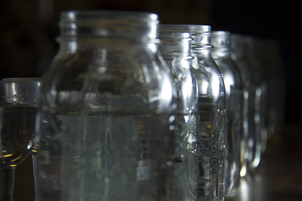 Mason jars and sipping glasses with spirits taken from the still at regular intervals so the workshop students at the Downslope Distillery can test for the optimal recipe for new whiskey.  downslope; distillery; whiskey; liquor; craft; denver; denverite; colorado; kevinjbeaty