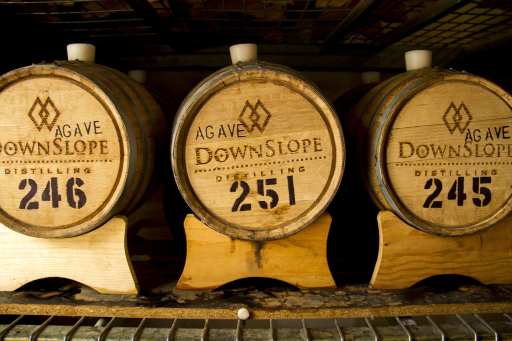 Whiskey casks at the Downslope Distillery.  downslope; distillery; whiskey; liquor; craft; denver; denverite; colorado; kevinjbeaty