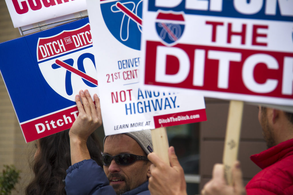 Protesters picket a meeting between city officials and US Transportation Secretary Anthony Foxx.  protest; activism; anthony foxx; michael hancock; cdot; smart cities; development; growth; infrastructure; transportation; highway; i70; i-70; denverite; denver; colorado; kevinjbeaty;