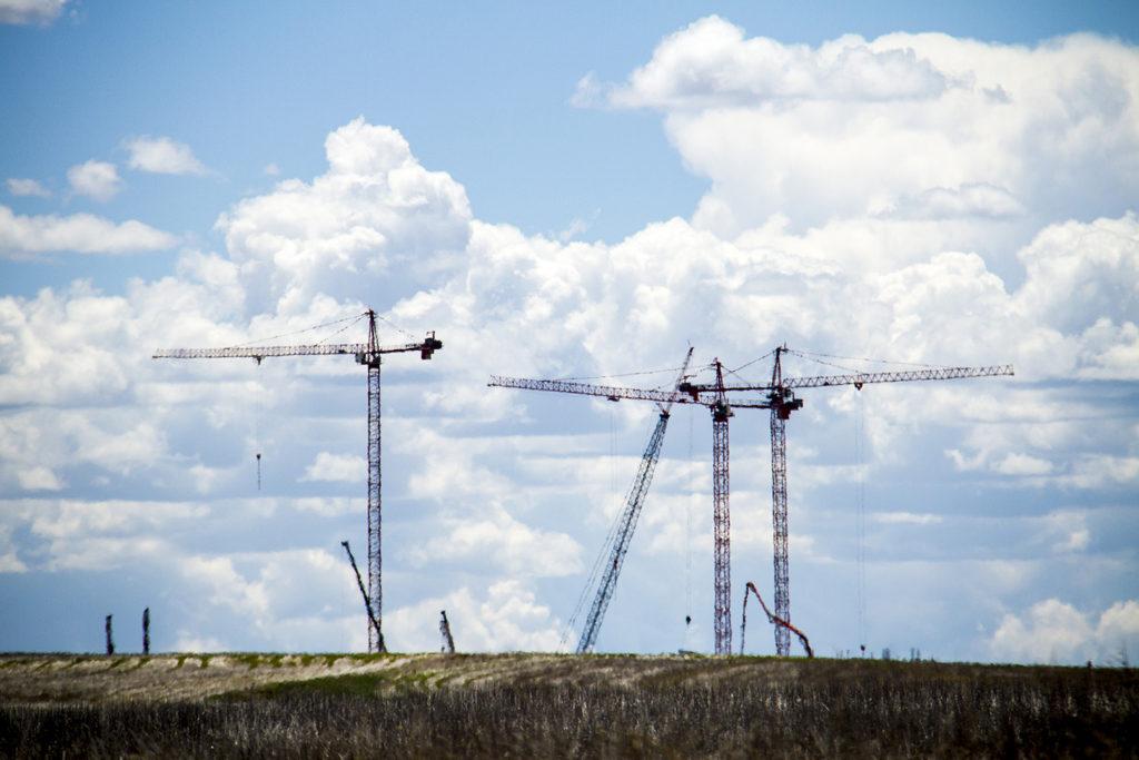 Cranes and a gaping skyline. (Kevin J. Beaty/Denverite)  cranes; construction; development; clouds; denver; denverite; colorado; kevinjbeaty