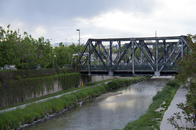 A pedestrian bridge over the Cherry Creek. (Kevin J. Beaty/Denverite)  bridge; cherry creek; water; infrastructure; river; denver; denverite; colorado; kevinjbeaty
