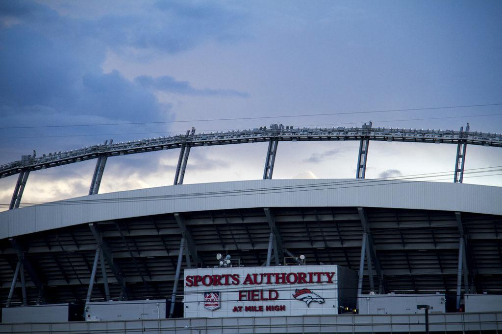 The sun sets over Sports Authority Field. (Kevin J. Beaty/Denverite)  sports; sports authority field; broncos; sunset; denver; denverite; colorado; kevinjbeaty
