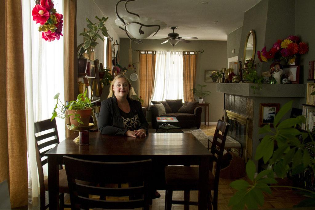 Jaime Marston Cook poses for a portrain inside her home in Elyria-Swansea. (Kevin J. Beaty/Denverite)  elyria; swansea; globeville; environment; development; i-70; i70; kevinjbeaty; denver; denverite; colorado;