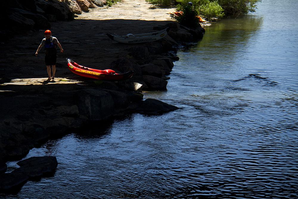 Kayakers exit the South Platte under the Speer River Bridge above Confluence Park. (Kevin J. Beaty/Denverite)  confluence park; platte river; kayak; sports; recreation; denver; denverite; colorado; kevinjbeaty