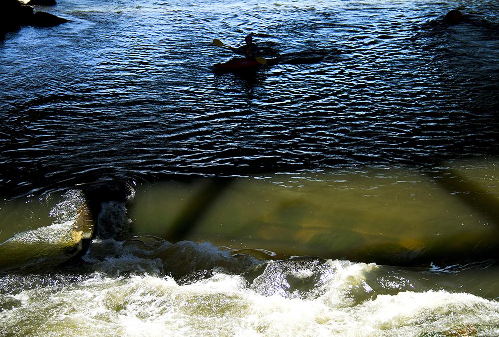 Alex Tyk, an experienced kayaker, cruises South Platte River rapids at Confluence Park. (Kevin J. Beaty/Denverite)  confluence park; platte river; kayak; sports; recreation; denver; denverite; colorado; kevinjbeaty
