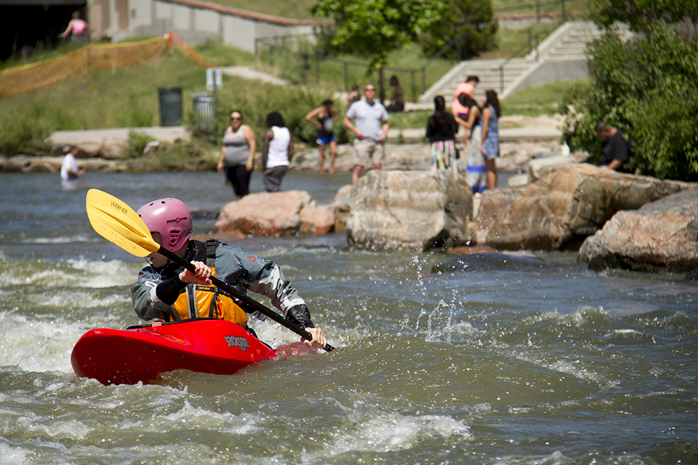 Alex Tyk, 28, successfully navigates the rapids at Confluence Park.. (Kevin J. Beaty/Denverite)  confluence park; platte river; kayak; sports; recreation; denver; denverite; colorado; kevinjbeaty