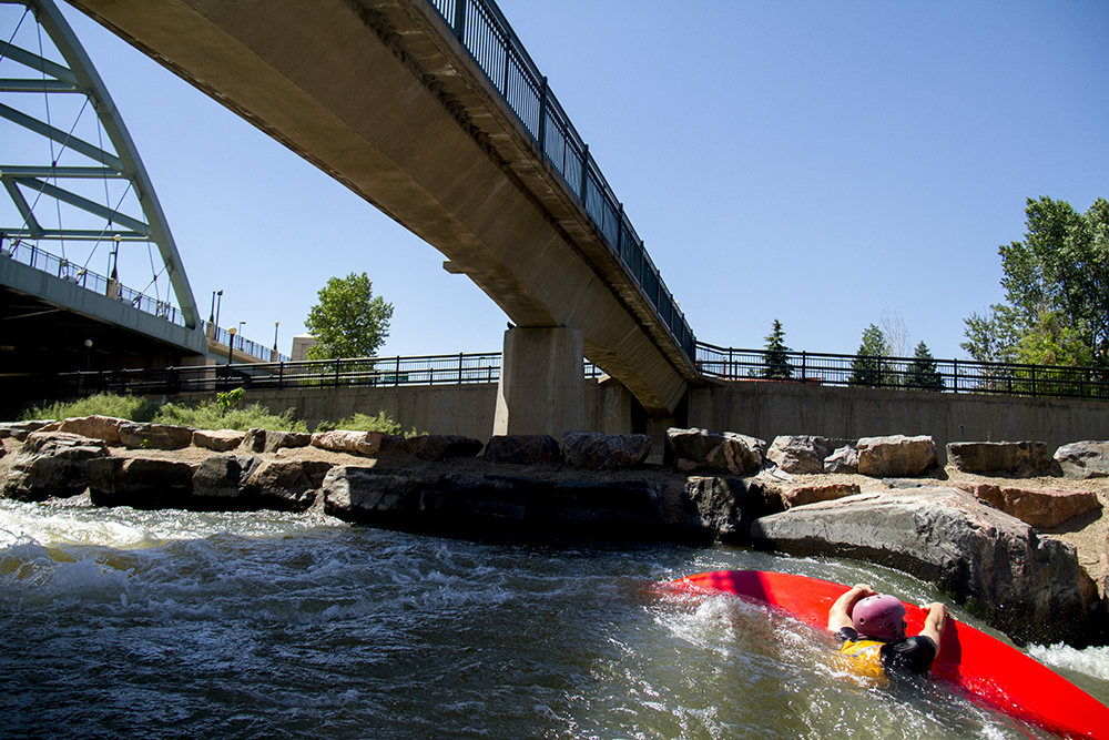 This is Shane Tucker's first time in a kayak and these rapids can be unforgiving. (Kevin J. Beaty/Denverite)  confluence park; platte river; kayak; sports; recreation; denver; denverite; colorado; kevinjbeaty; rapids