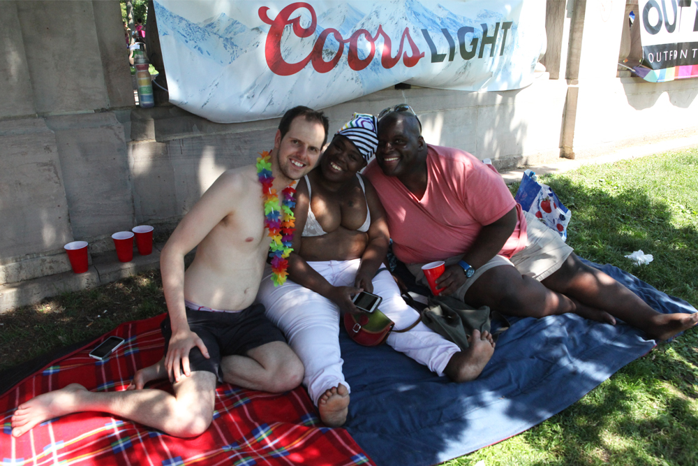 "Friends since college, Crystal, Matthew and Nathan take a break from the sun. ""Denver may not be a gay mecca per say, but it has a live and let live attitude,"" Nathan said. ""There's a level of respect here you don't see other places."" (Chloe Aiello/Denverite)"