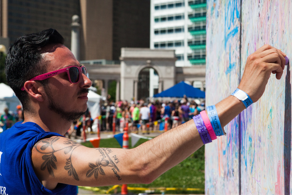"Austin, 25, wrote, ""You are in our hearts."" He thinks Pride is important because it encourages people to unite in the face of hate. (Chloe Aiello/Denverite)"