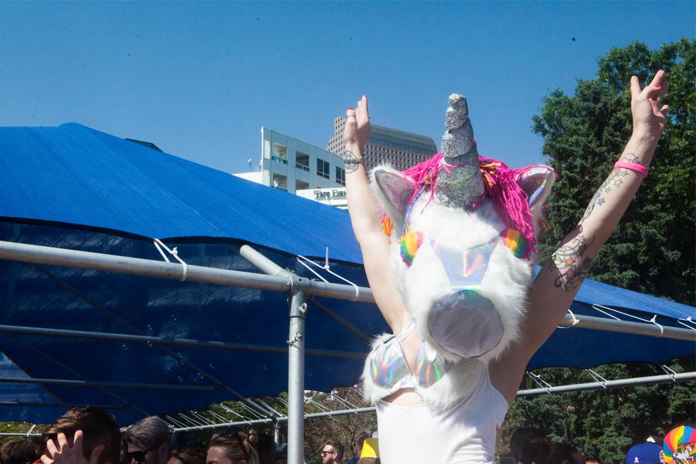 A gogo dancer in a unicorn mask pumped up the crowd. (Chloe Aiello/Denverite)