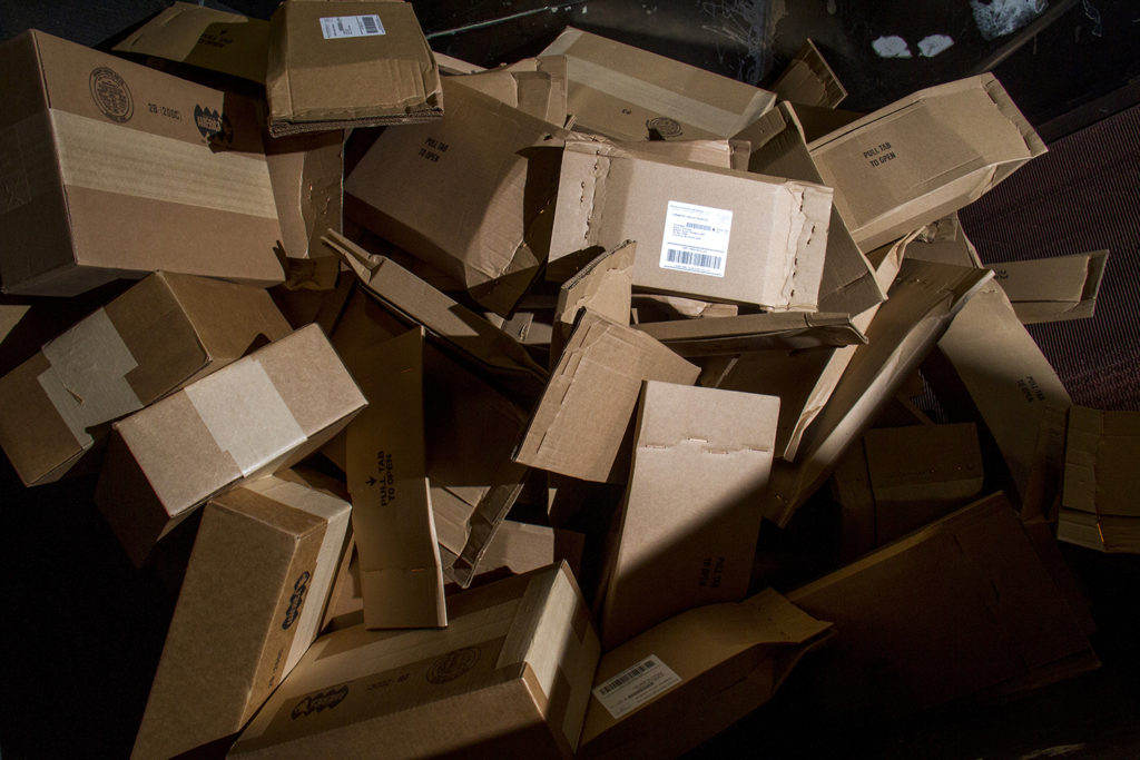 A pile of parcels at the US Postal Service's sorting and shipping hub. (Kevin J. Beaty/Denverite)  mail; amazon; shipping; usps; postal service; logistics; economics; denverite; denver; colorado; kevinjbeaty;