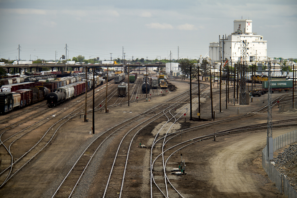 A trainyard before the Denver skyline. (Kevin J. Beaty/Denverite)  skyline; cityscape; train; denver; colorado; kevinjbeaty; denverite;
