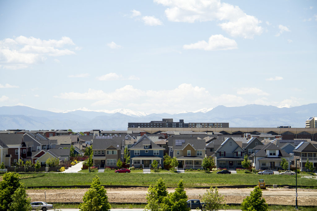 Stapleton residences as seen from a hill in Central Park. (Kevin J. Beaty/Denverite)  stapleton; central park; residential; suburbs; homes; denverite; denver; colorado; kevinjbeaty