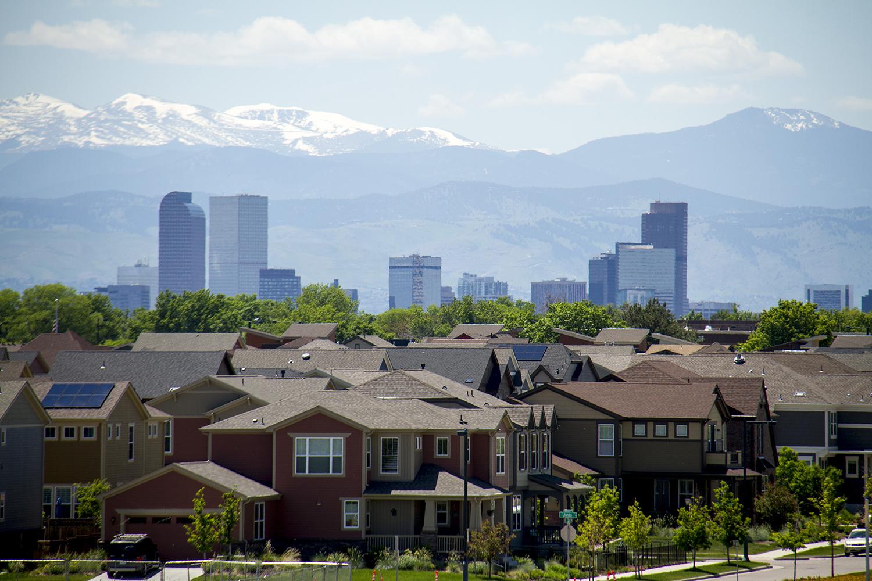 Stapleton residences under downtown Denver's skyline. (Kevin J. Beaty/Denverite)