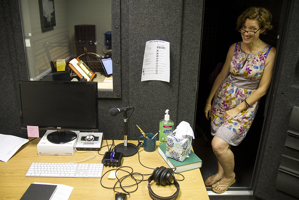 Mare Trevathan stands in the sound booth where she's recording a book reading for the National Library Service for the Blind and Physically Handicapped. (Kevin J. Beaty/Denverite)  voiceover; voice acting; books on tape; denver; colorado; denverite; kevinjbeaty;