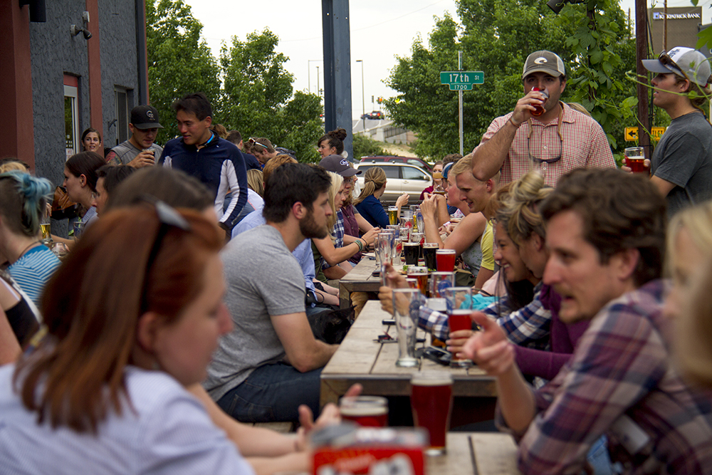 A packed patio at Denver Beer Co. in Highland. (Kevin J. Beaty/Denverite)