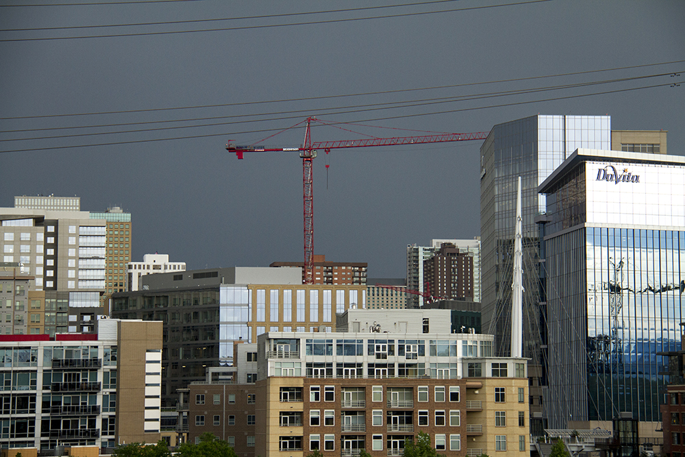 Stormy clouds hover over downtown Denver. (Kevin J. Beaty/Denverite)  skyline; clouds; stormy; weather; cowx; denver; colorado; kevinjbeaty; denverite