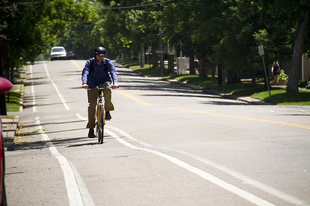 A biker cruises westbound on 16th Street. (Kevin J. Beaty/Denverite)  bike; sixteenth street; 16th street; city park west; kevinjbeaty; colorado; denver; denverite;