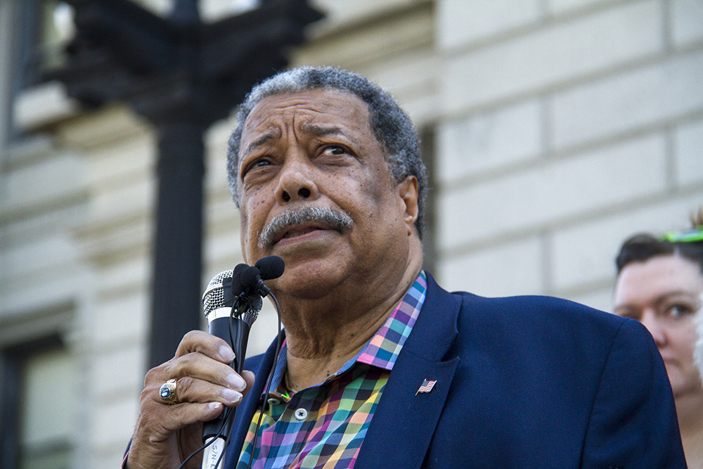 Former Denver Mayor Wellington Webb speaks at a press conference calling out Donald Trump as a racist on the Colorado State Capitol steps. June 8, 2016. (Kevin J. Beaty/Denverite)  wellington webb; denver; denverite; governor john hickenlooper; capitol; capitol hill; speech; kevinjbeaty; colorado