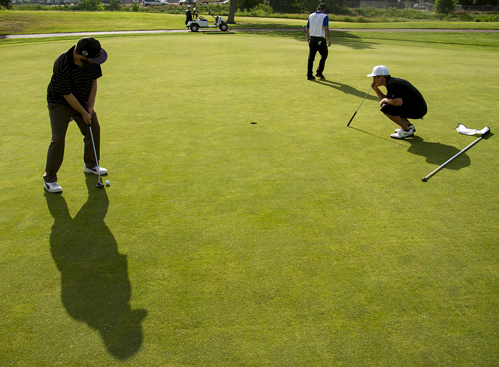(Left to right) Charles Banner, Kyle Woods, and Blaze Heuga play a round at the Park Hill Golf Club. (Kevin J. Beaty/Denverite)  park hill; golf course; denver; denverite; kevinjbeaty; colorado; sports;