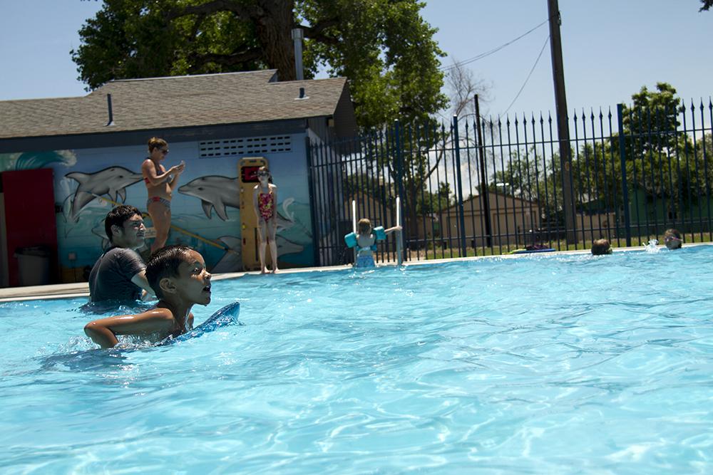 Kids cool off in the pool at Globeville's Argo Park. (Kevin J. Beaty/Denverite)  argo park; globeville; summer; pool; kids; kevinjbeaty; denver; denverite; colorado;