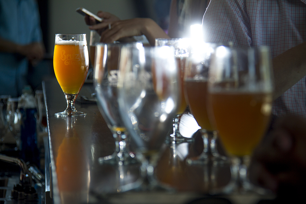 Bruz Beers' Summerfield Saison illuminated on the bar during the brewery's soft open in Twin Lakes on June 9, 2016. (Kevin J. Beaty/Denverite)  beer; brewery; bruz; twin lakes; denver; colorado; food; kevinjbeaty; denverite;