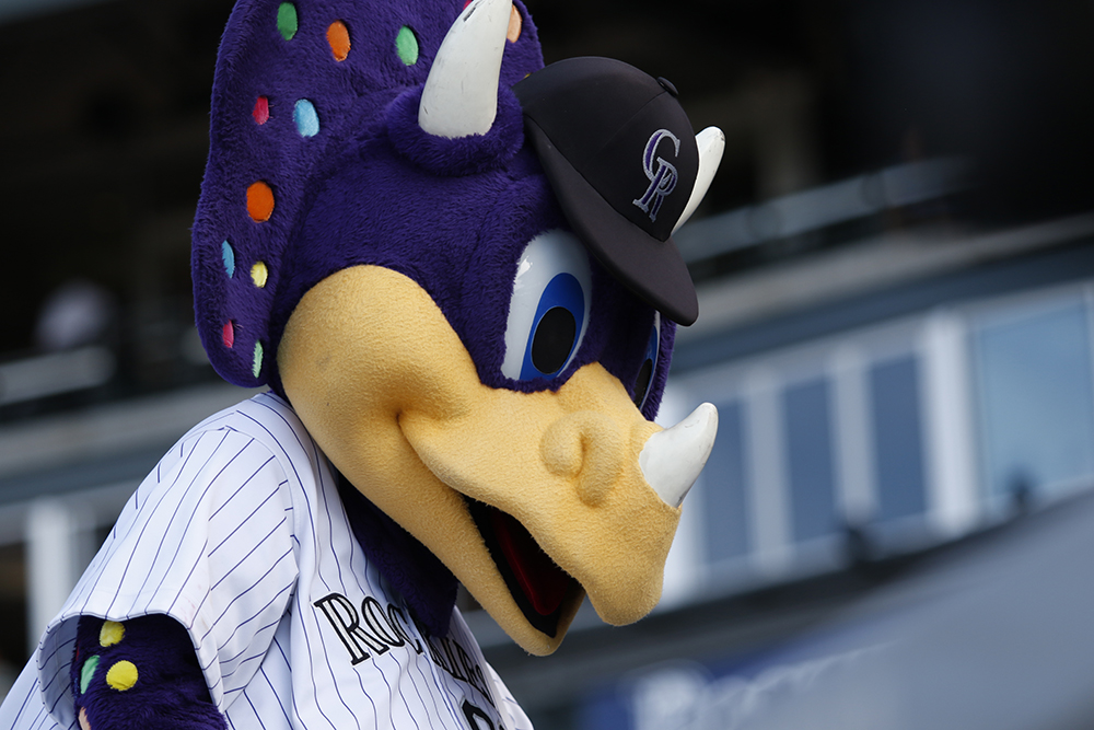 Colorado Rockies mascot Dinger dances around on top of the opponents dugout during the game against   Pittsburgh Pirates Coors Field, June 9, 2016.  Rockies win 11-5 (Jessica Taves/For Denverite)  colorado rockies; baseball; sports; jessica taves; denver; colorado; denverite