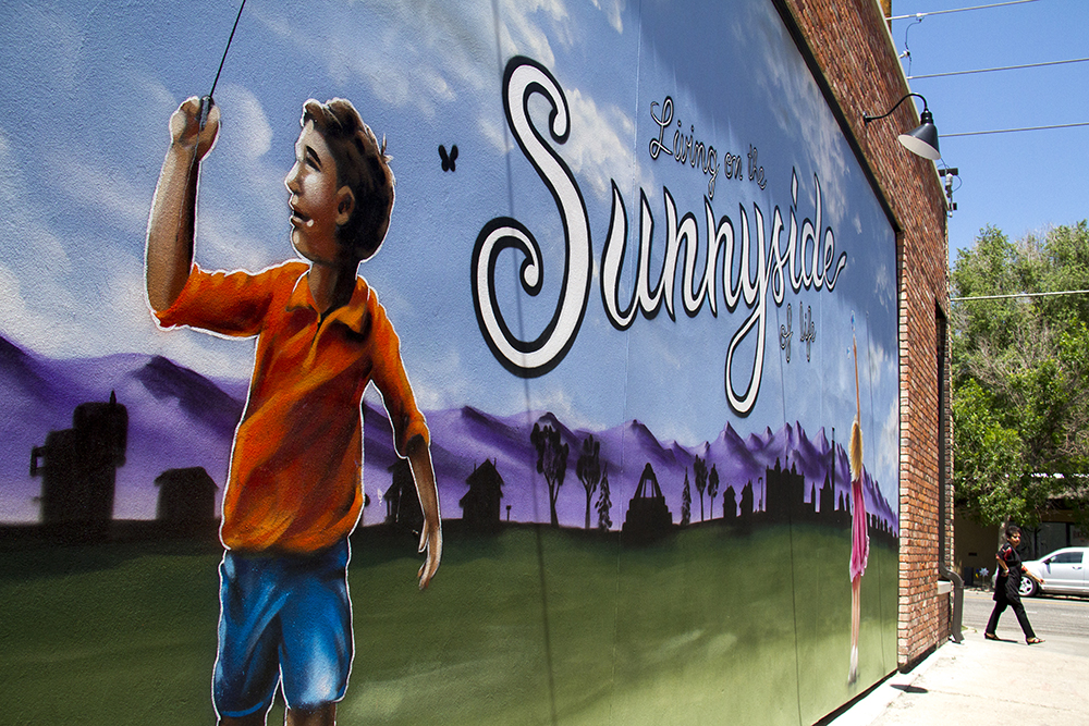 """""""Living on the Sunnyside,"""" painted on the side of Lombards On The Avenue, a barber shop on 44th Avenue in Sunnyside. (Kevin J. Beaty/Denverite)"""