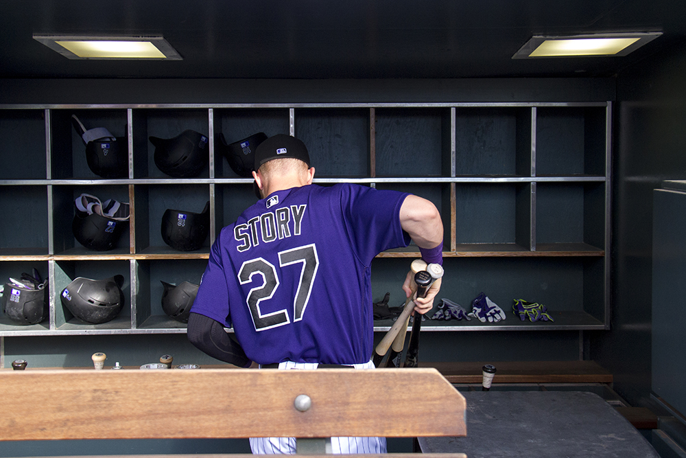 Trevor Story loads bats into the dugout before the Colorado Rockies Game against the San Diego Padres on June 10, 2016. (Kevin J. Beaty/Denverite)