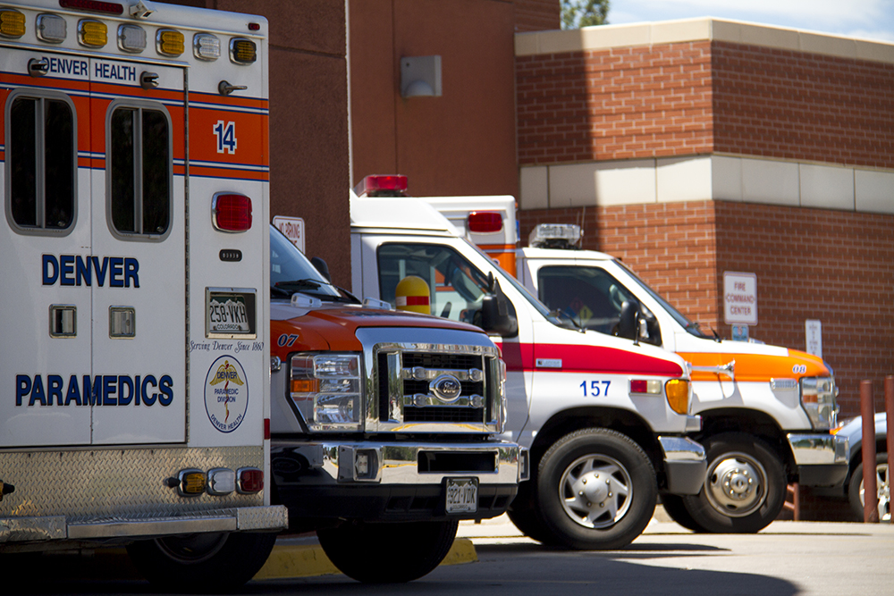Ambulances at Denver Health on Bannock in Lincoln Park. (Kevin J. Beaty/Denverite)  denver health; hospital; healthcare; denver; denverite; kevinjbeaty; colorado;