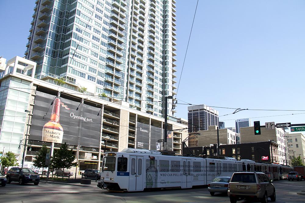 An RTD train crosses 14th Street. (Kevin J. Beaty/Denverite)