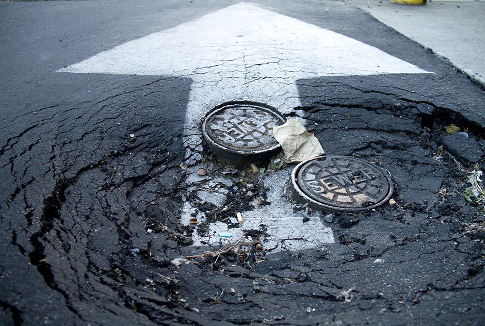A massive pothole in Capitol Hill. (Kevin J. Beaty/Denverite)  colfax; pothole; roads; streets; capitol hill; kevinjbeaty; denver; denverite; colorado;