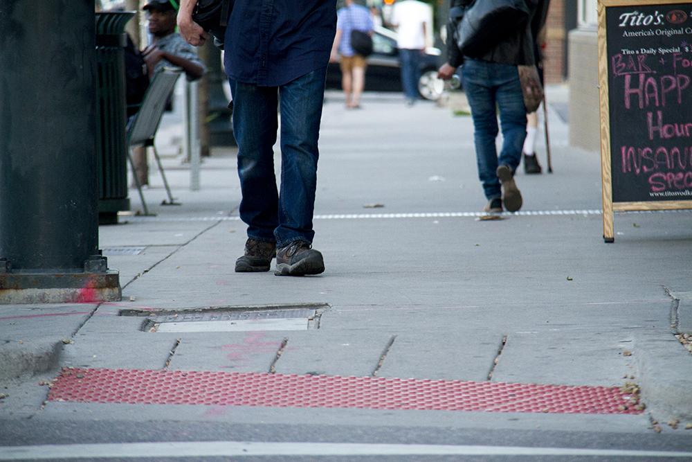 Pedestrians on Colfax. (Kevin J. Beaty/Denverite)