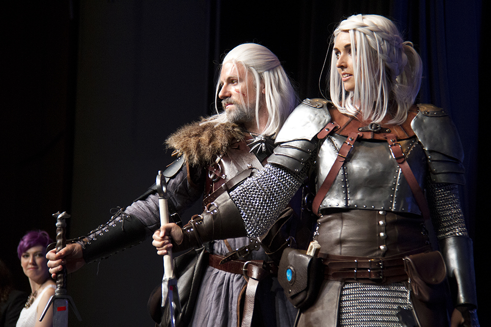 Giralt of Rivia and Ciri from the Game, the Witcher, on stage at the Denver Comic Con Cosplay Shindig on June 18, 2016. (Kevin J. Beaty/Denverite)  denver comic con; convention center; denver; colorado; denverite; kevinjbeaty