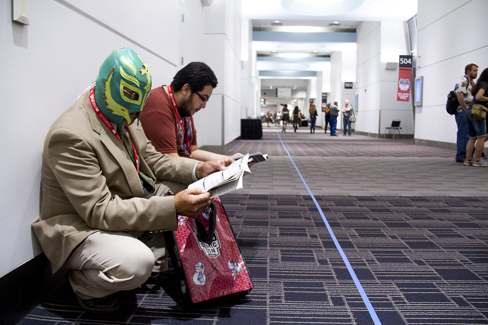 Matthew and Eric Montoya kill time on the last day of Denver Comic Con. June 19, 2016. (Kevin J. Beaty/Denverite)  denver comic con; convention center; denver; colorado; denverite; kevinjbeaty