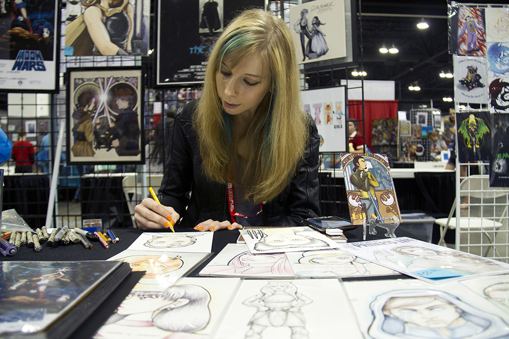 Boulder-based illustrator Diane Harrop, who works under the name DiHa, drawing at her booth at Denver Comic Con. June 19, 2016. (Kevin J. Beaty/Denverite)  denver comic con; convention center; denver; colorado; denverite; kevinjbeaty