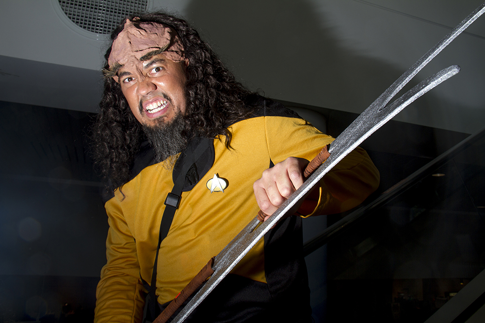 Roy Jobes, dressed as Star Trek's Worf, unleashes a Klingon roar on the ecallator. Denver Comic Con on June 19, 2016. (Kevin J. Beaty/Denverite)  denver comic con; convention center; denver; colorado; denverite; kevinjbeaty