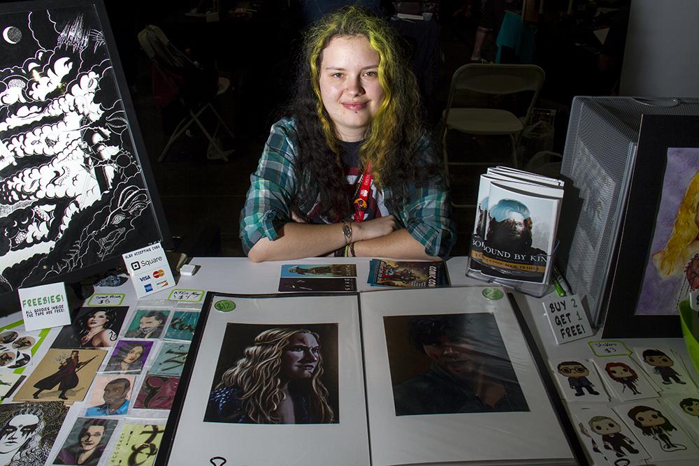 Katy L. Wood behind her booth at Denver Comic Con on June 19, 2016. (Kevin J. Beaty/Denverite)  denver comic con; convention center; denver; colorado; denverite; kevinjbeaty