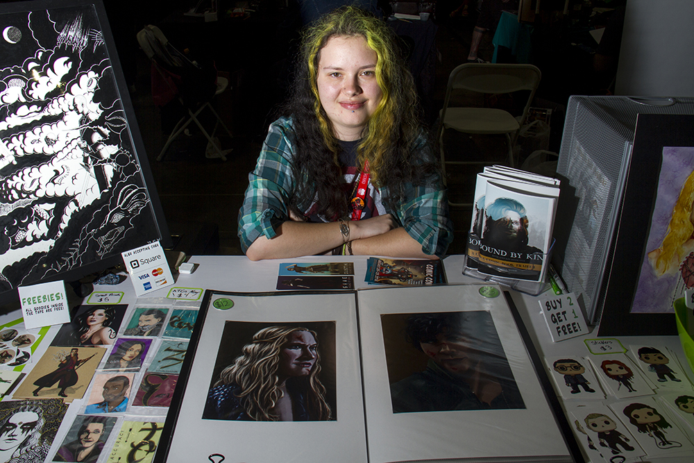 Katy L. Wood behind her booth at Denver Comic Con on June 19, 2016. (Kevin J. Beaty/Denverite)  denver comic con; convention center; denver; colorado; denverite; kevinjbeaty
