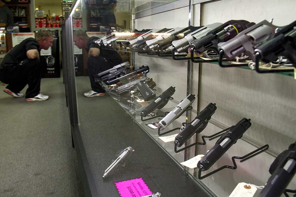 A display case of pistols at Hammer Down Firearms in Wheat Ridge. (Kevin J. Beaty/Denverite)  guns; firearms; retail; kevinjbeaty; denver; denverite; colorado;