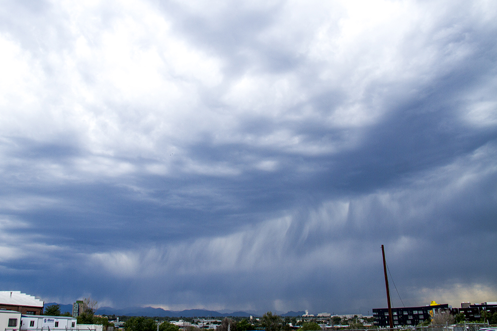 Rainclouds over the Rockies, looking westword from RiNo. (Kevin J. Beaty/Denverite)  weather; rain; clouds; front range; mountains; denver; denverite; kevinjbeaty; colorado