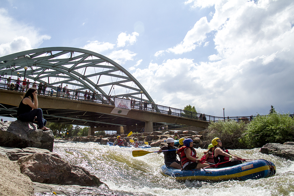 Thamys Gaertner watches boaters from a rock beside the South Platte during Riverfest at Confluence Park. June 25, 2016. (Kevin J. Beaty/Denverite)  south platte river; south platte riverfest; confluence park; denver; denverite; kevinjbeaty; colorado;