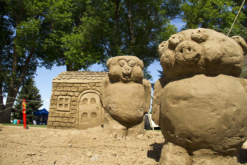 Two of potentially three little piggies molded from ultra-fine sand at Arvada's Sand in the City festival on June 25, 2016. (Kevin J. Beaty/Denverite)  sand in the city; sand castle; summer; festival; arvada; denver; kevinjbeaty; denverite; colorado;