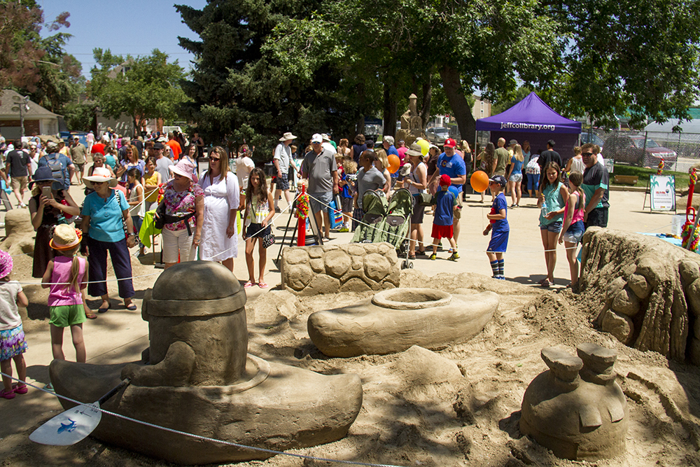 """A """"Despicable Me""""-themed sand installation at Arvada's Sand in the City festival on June 25, 2016. (Kevin J. Beaty/Denverite)  sand in the city; sand castle; summer; festival; arvada; denver; kevinjbeaty; denverite; colorado;"""