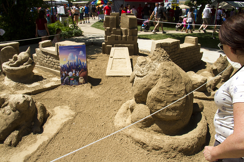 """A sand installation depicting characters from """"The Secret Life of Pets"""" at Arvada's Sand in the City festival on June 25, 2016. (Kevin J. Beaty/Denverite)  sand in the city; sand castle; summer; festival; arvada; denver; kevinjbeaty; denverite; colorado;"""