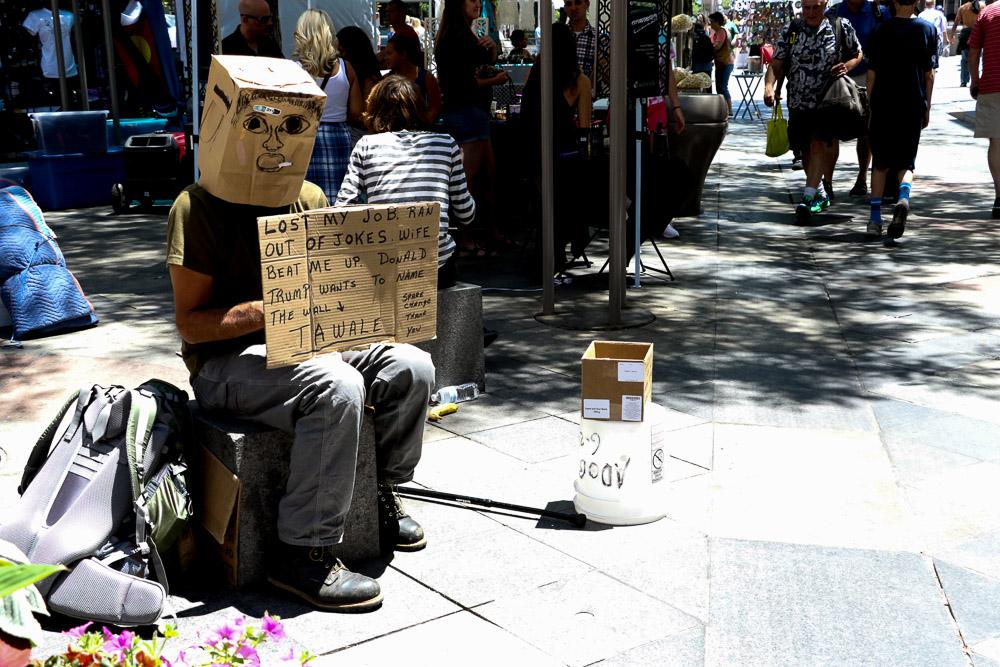 A man on the 16th Street Mall. (Denverite/Chloe Aiello)